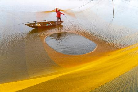 Fisherman working on the nets