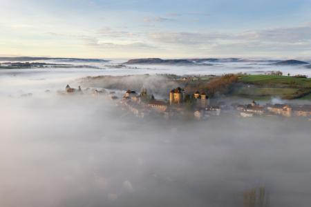Curemonte in the morning mist in the autumn, Correze, France
