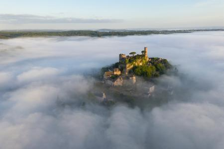 Aerial view of Turenne surrounded by mist at sunrise, Correze, France