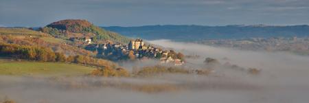 Curemonte in the morning mist in the autumn, Correze, Nouvelle-aquitaine, France