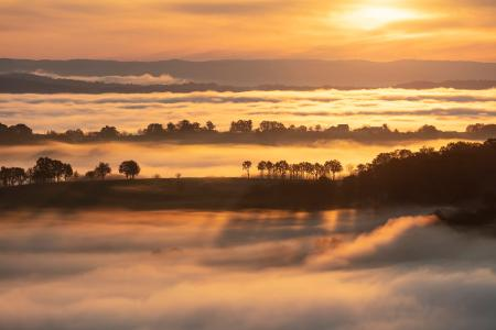 Misty morning in Turenne at sunrise, Correze, France