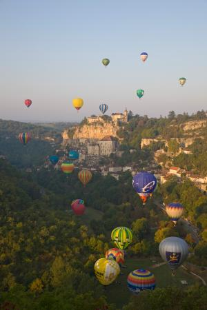 Hot air balloons fly over Rocamadour, Lot, France
