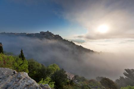 Gordes in the mist at sunrise, Provence, France