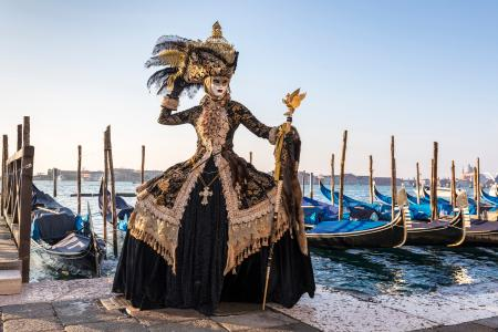 Striking costume by the lagoon during the Venice Carnival