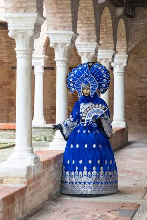 Lady in blue among the cloisters